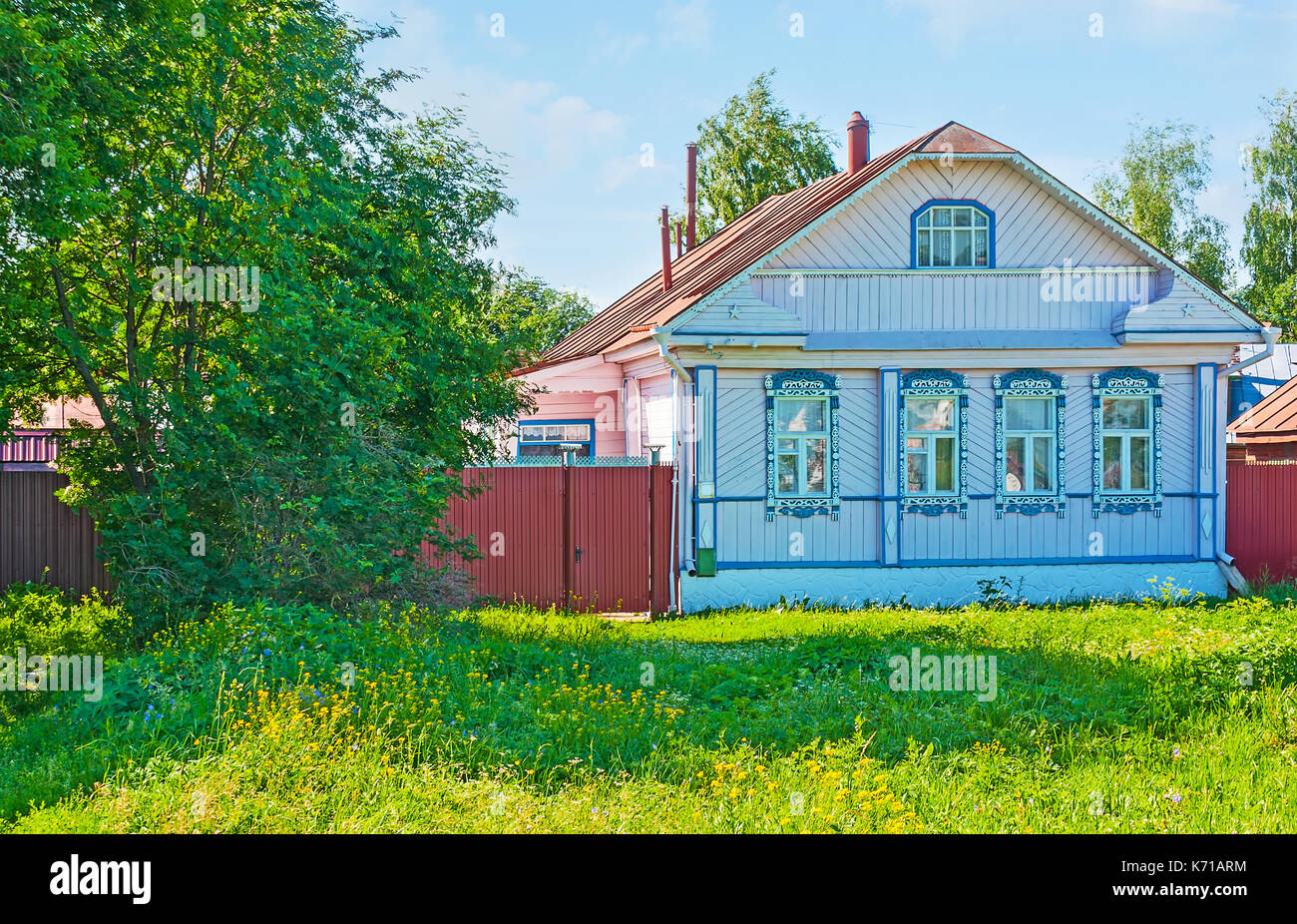 Historic timbered house, decorated with carved colored window frames in Suzdal, Russia. Stock Photo