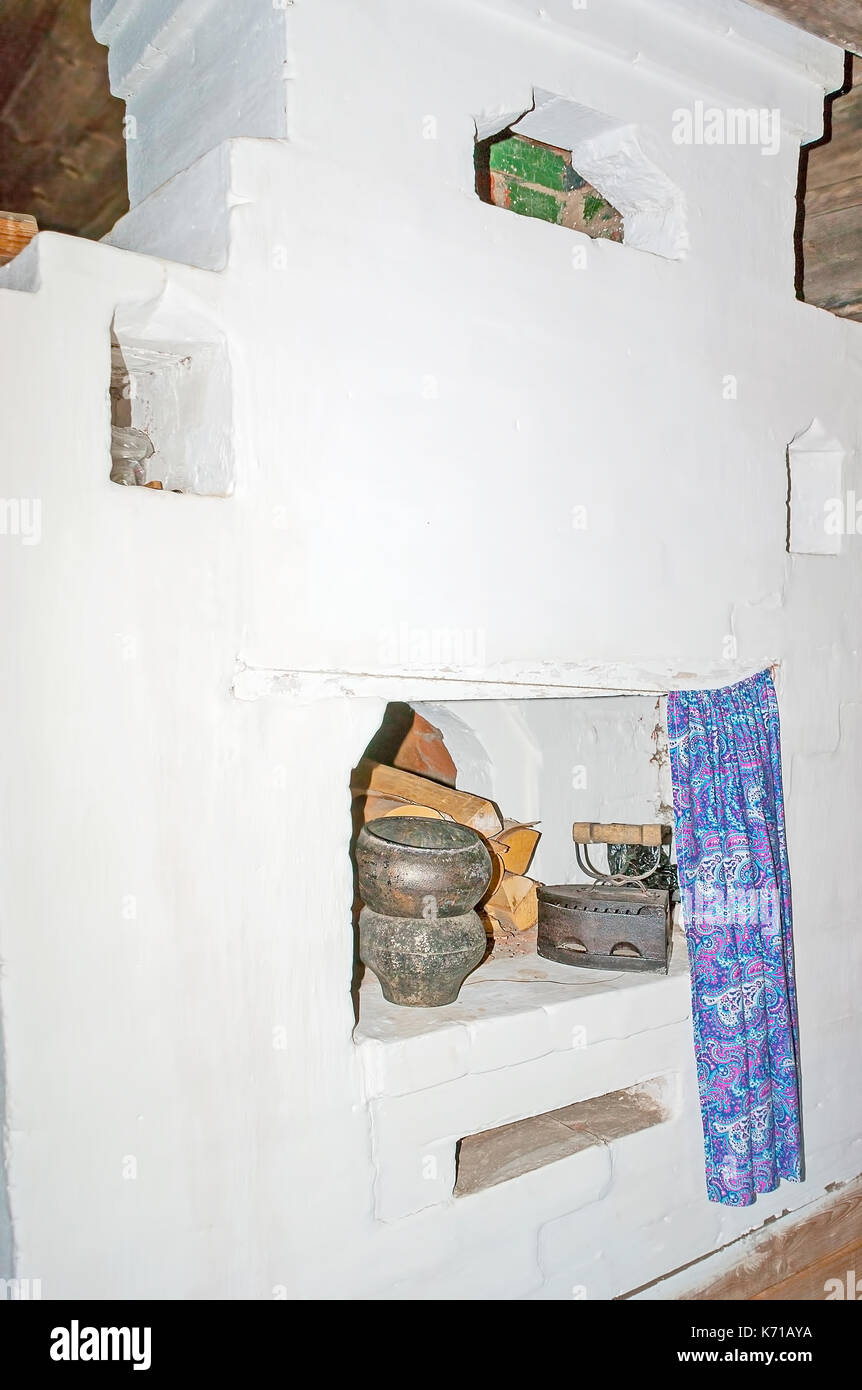 SUZDAL, RUSSIA - JULY 1, 2013: The important detail of traditional peasants house (izba) is the Russian oven, Museum of Wooden Architecture and Peasan - Stock Image