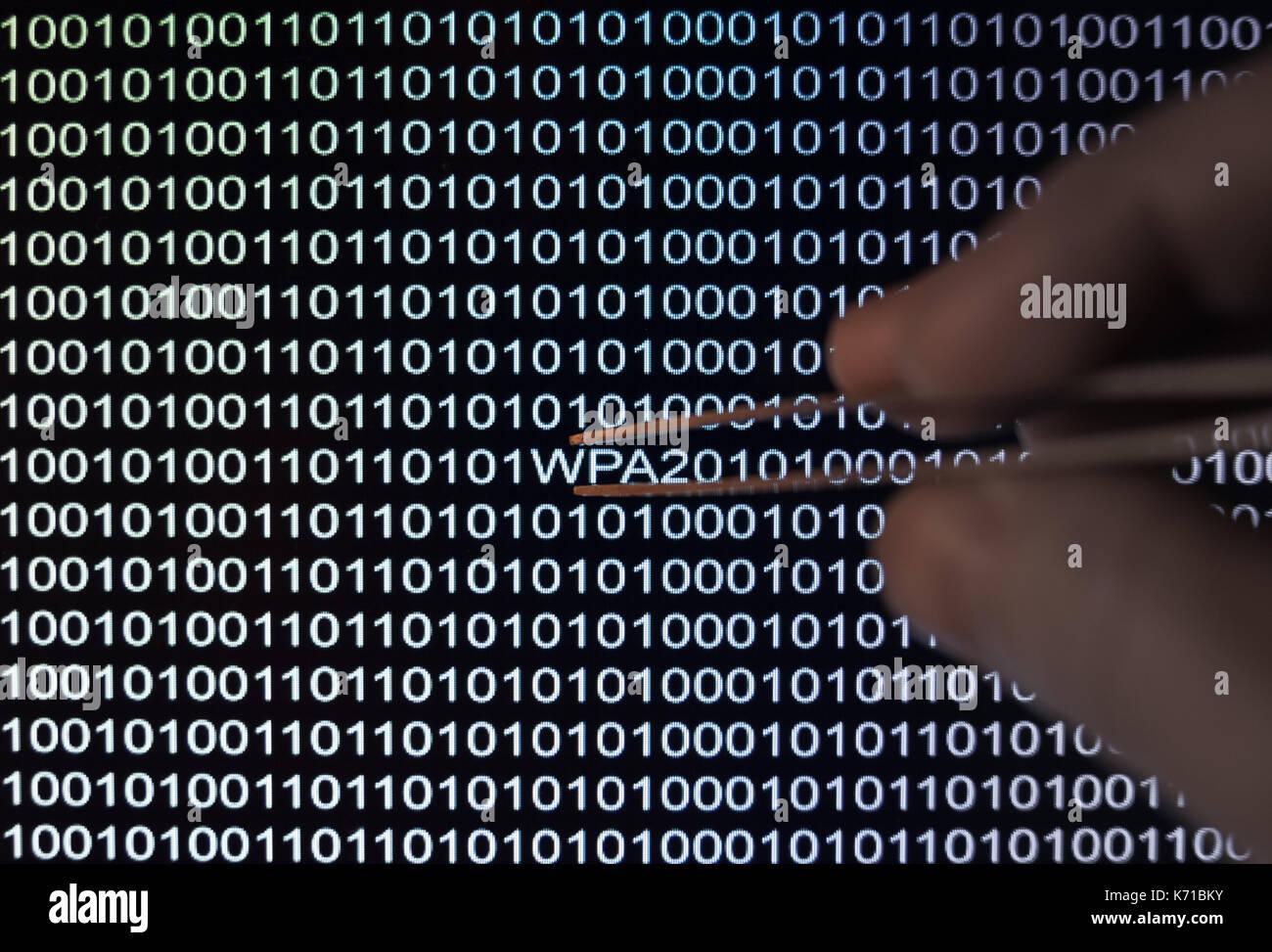 Binary code, hacker finds Wireless wifi password Stock Photo