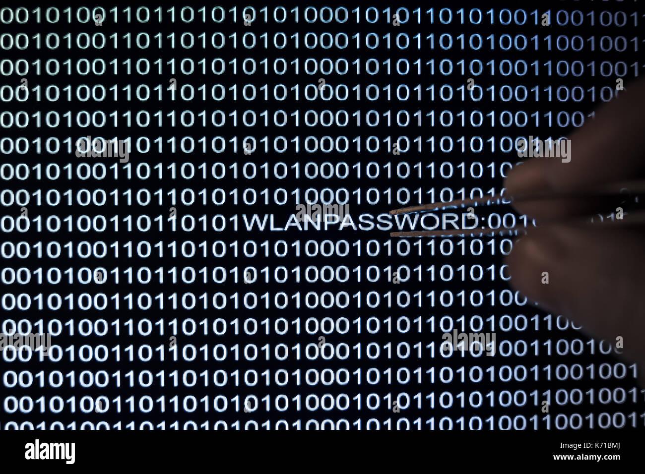 Binary code, Hacker with tweezers finds wireless password - Stock Image