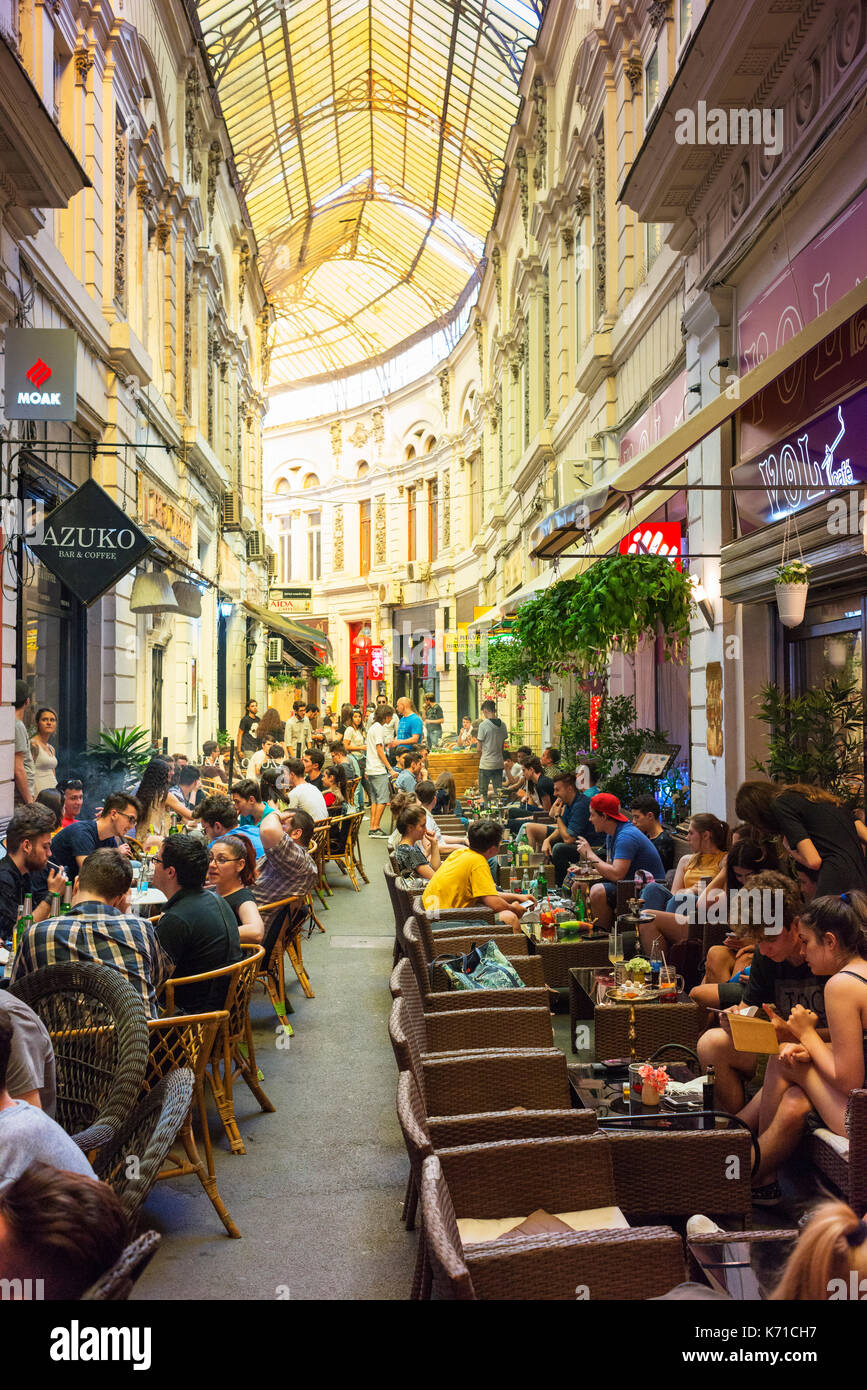People meet for a drink at cafes and pubs in the forked lane Pasajul Macca-Vilacrosse in central Bucharest. - Stock Image