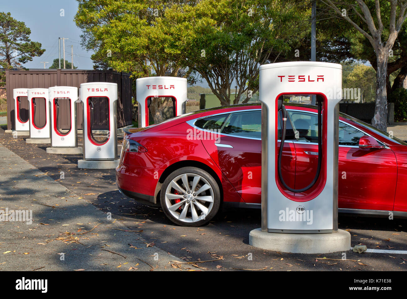 Tesla 'S'  sedan connected to 480 volt  Supercharger (fast charging)  Station. - Stock Image