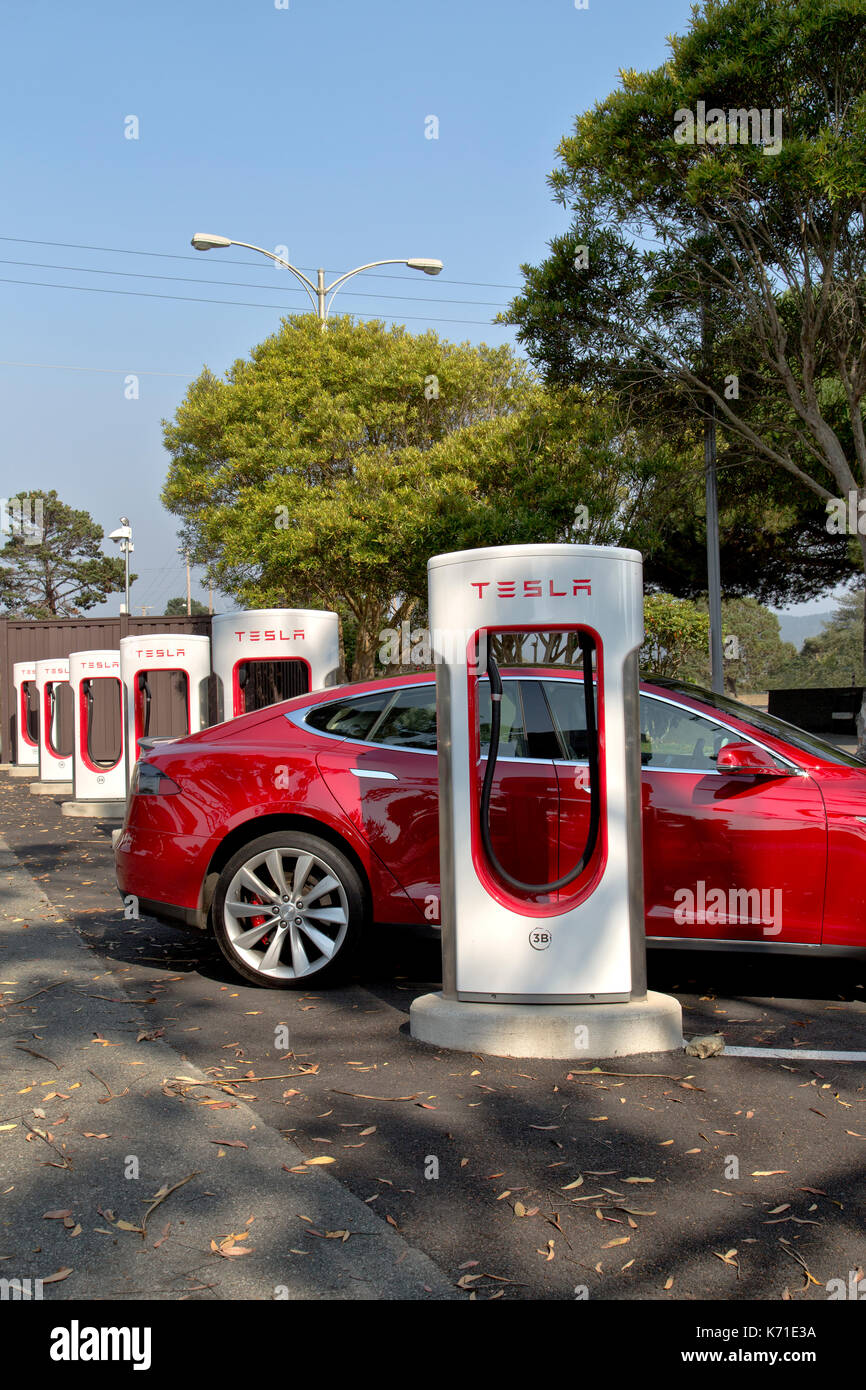 Tesla 'S' sedan connected to 480 volt (fast charging) Supercharger Station. - Stock Image