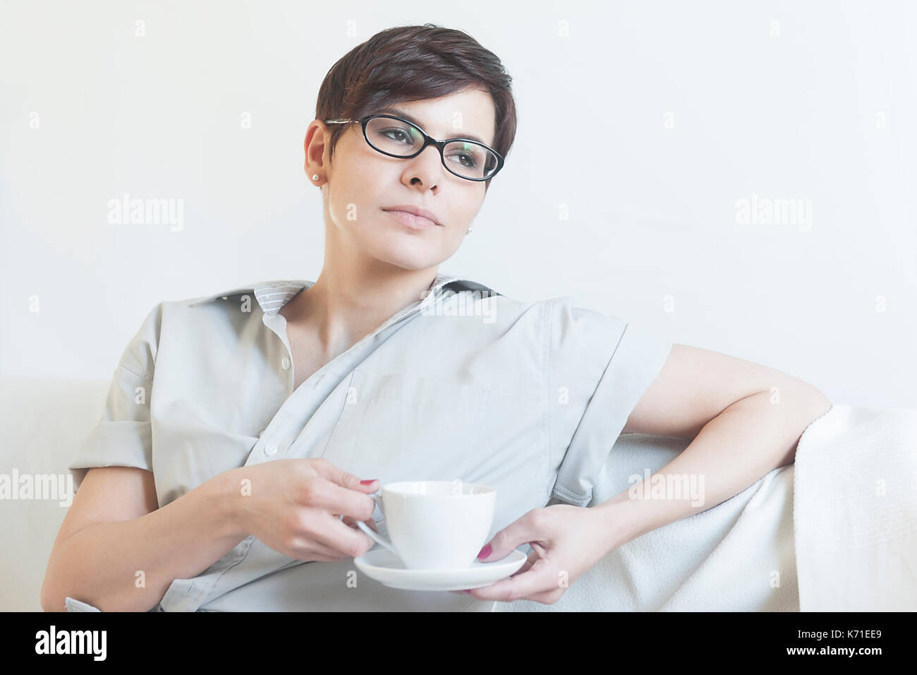 young woman having coffee - Stock Image
