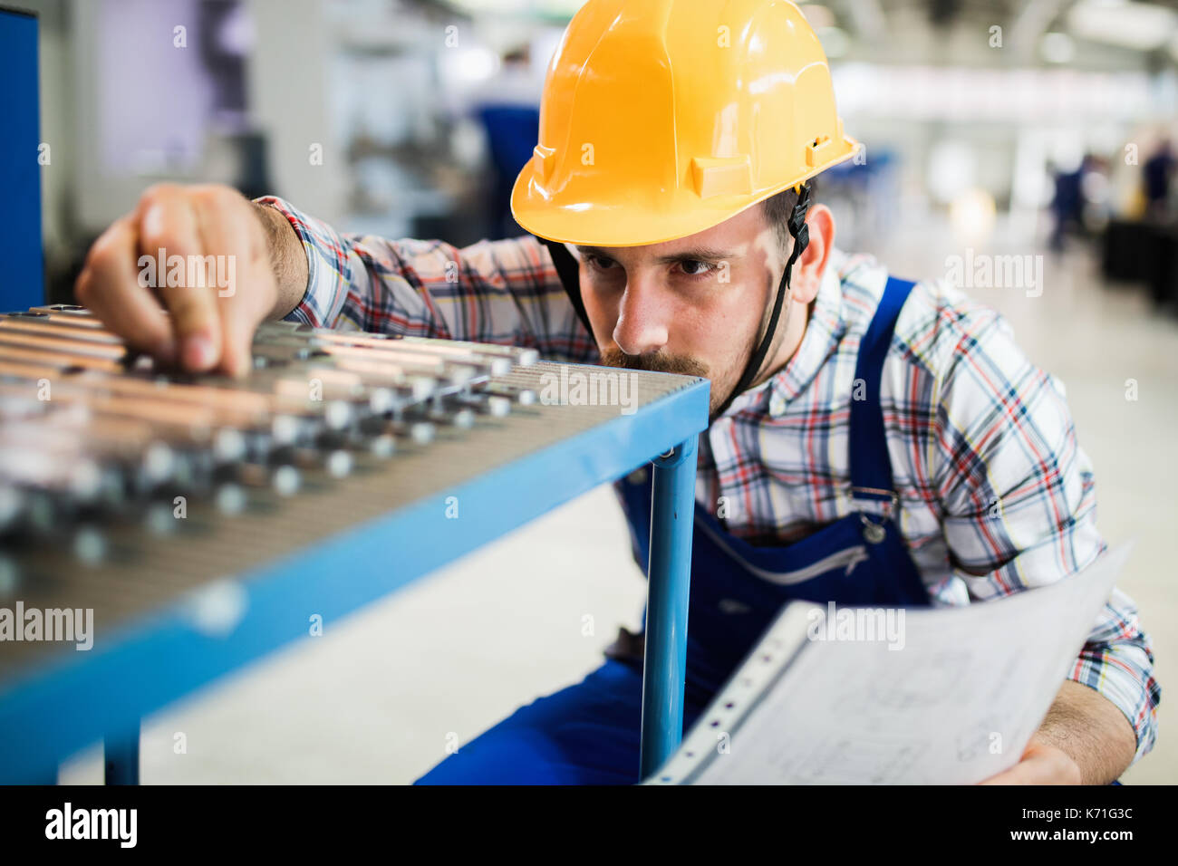 Supervisor doing quality control and pruduction check in factory - Stock Image