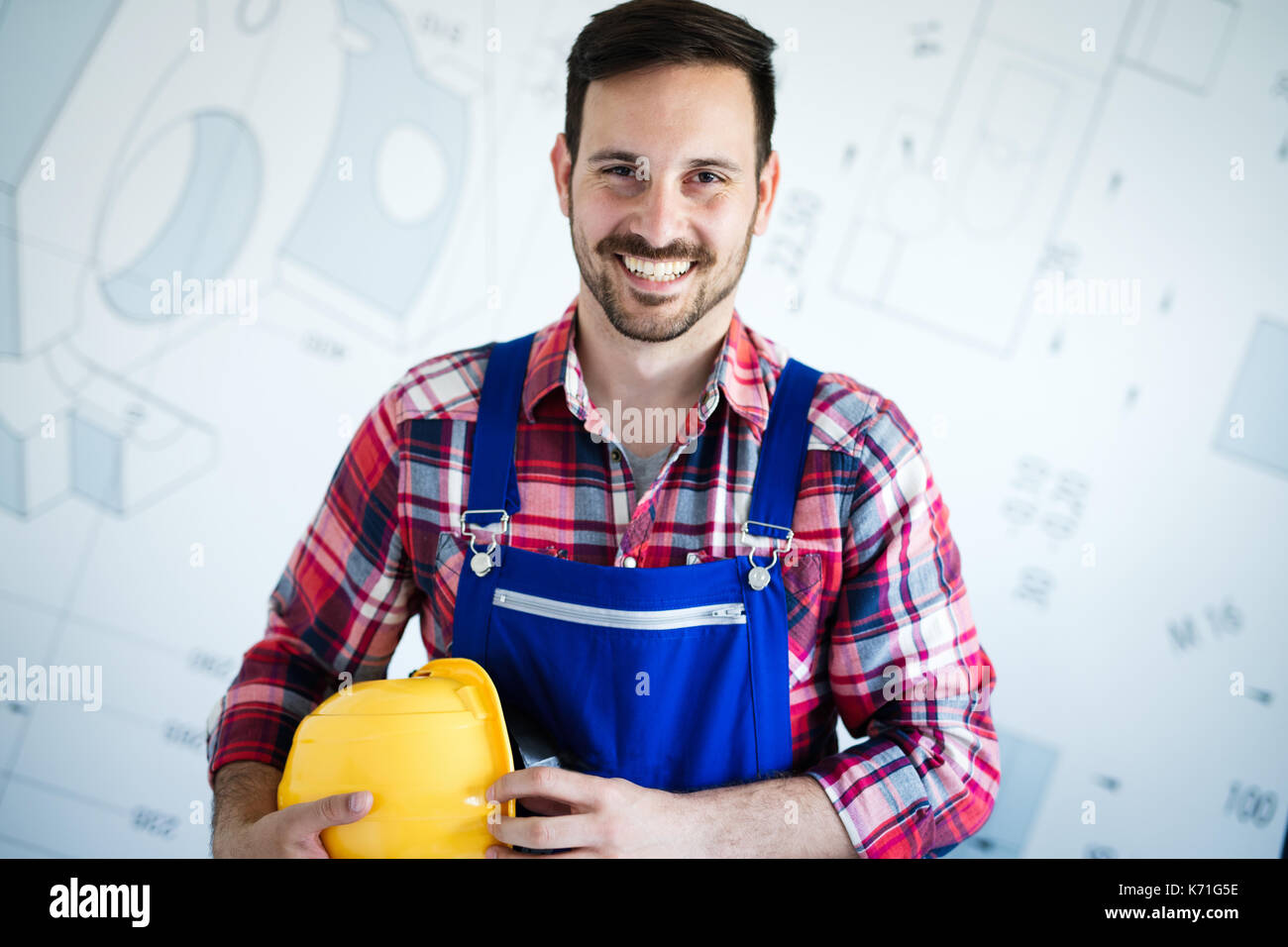 Portrait of Young mechanic with crossed arms - Stock Image