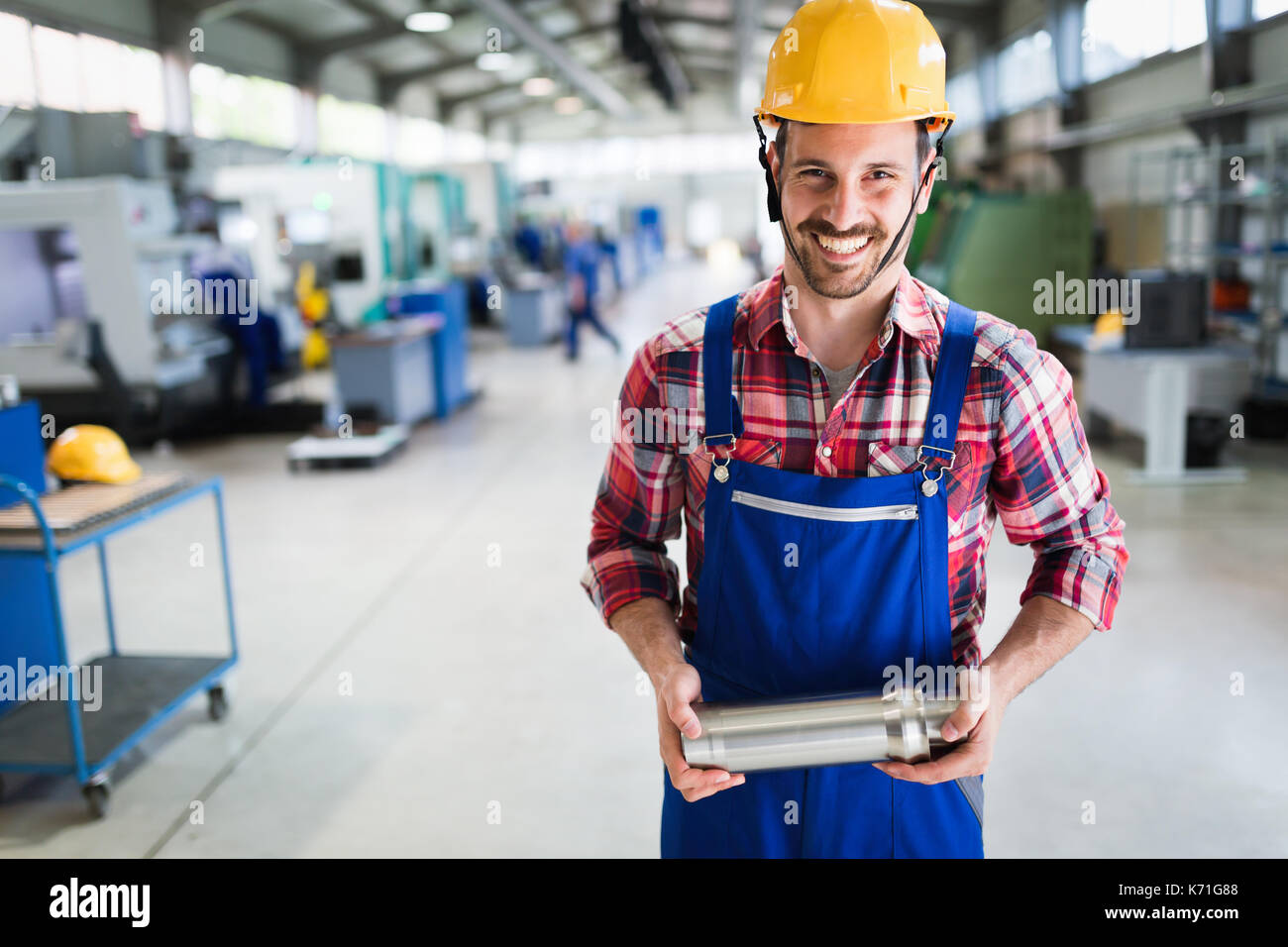 Portrait of an metal engineer working at factory Stock Photo