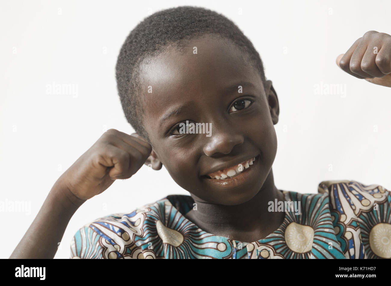 Happy African child excited with his hands up, isolated on white - Stock Image
