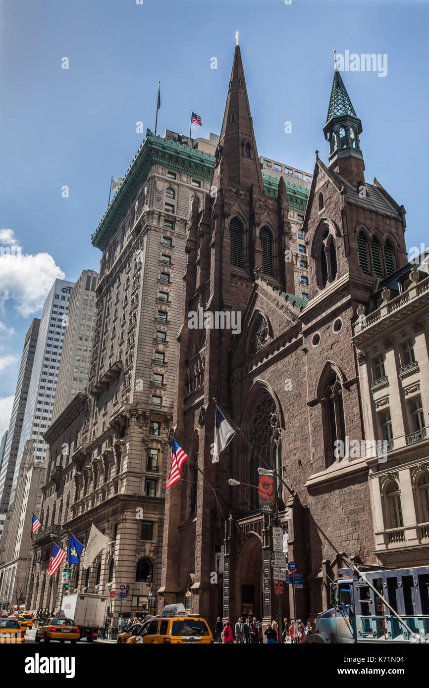 Fifth Avenue Presbyterian Church and The Peninsula Hotel on Fifth Avenue in Manhattan, New York City - Stock Image
