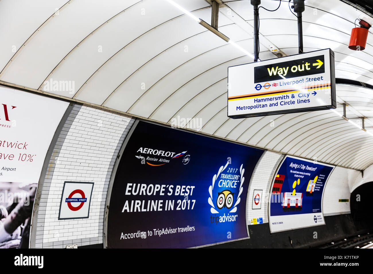 London Underground way out sign, London Underground way out, London Underground tube line, London Underground adverts, London Underground advertising, - Stock Image