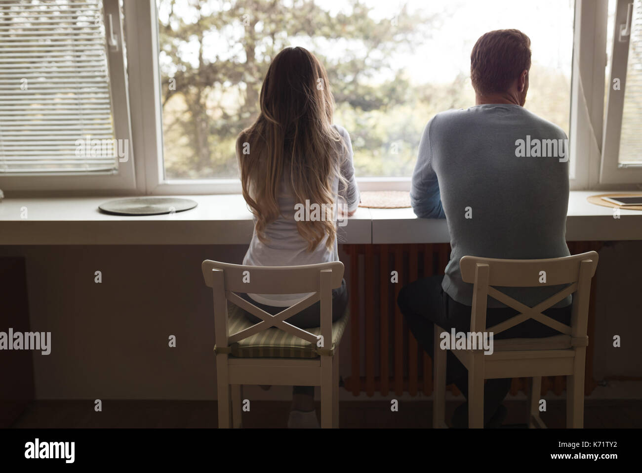 Couple having relationship problems and  arguing over infidelity - Stock Image