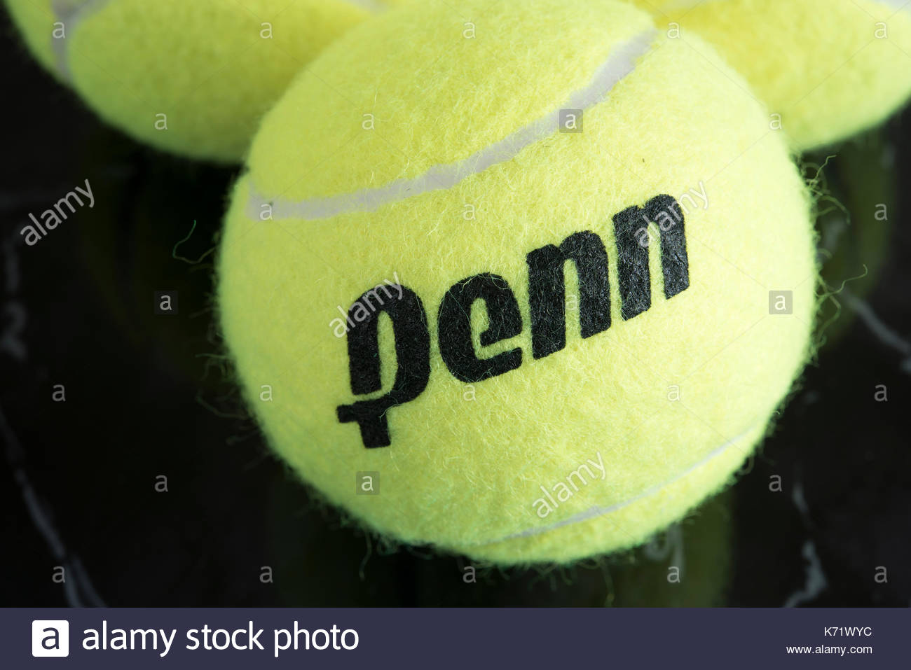Penn company tennis ball. The yellow felt on it has two white lines ...