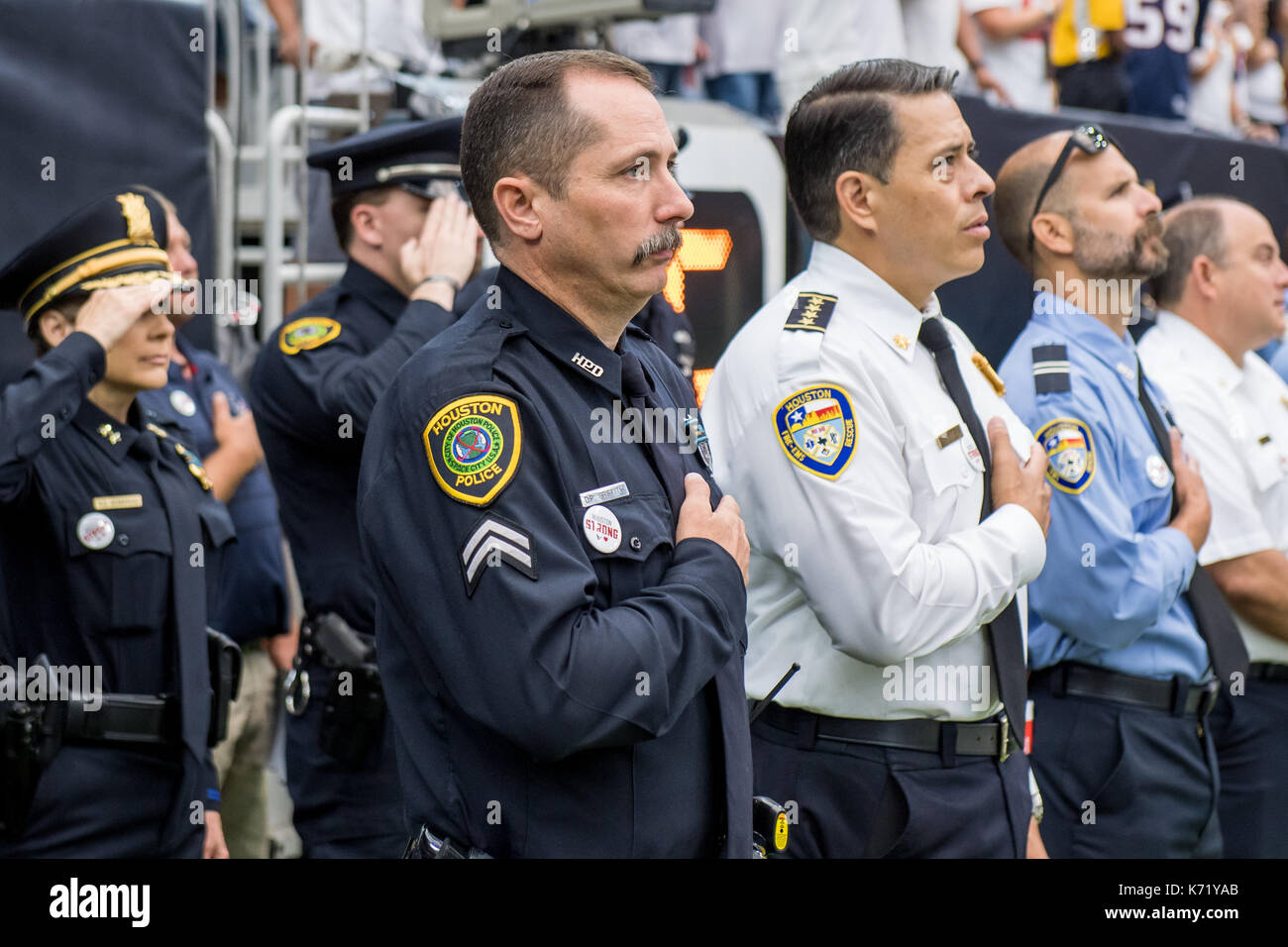 Houston, TX, USA. 10th Sep, 2017. Houston first-responders, including members of the Houston Police Department and Houston Fire Department, are recognized as they stand for the national anthem prior to an NFL football game between the Houston Texans and the Jacksonville Jaguars at NRG Stadium in Houston, TX. The Jaguars won the game 29-7.Trask Smith/CSM/Alamy Live News - Stock Image