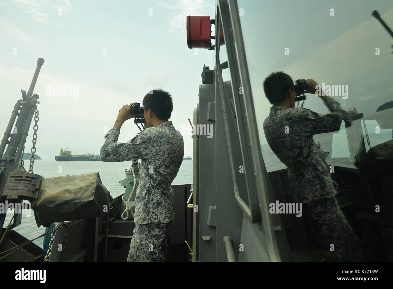 Singapore. 14th Sep, 2017. A sailor of Singapore Navy looks for the missing sailors of the collision accident in the west part of Singapore Strait on Sept. 14, 2017. The Maritime and Port Authority of Singapore (MPA) announced Wednesday evening that divers have recovered two bodies of missing crew members from a dredger which had collided earlier in the day with a tanker in Singapore's territorial waters. Credit: Then Chih Wey/Xinhua/Alamy Live News - Stock Image