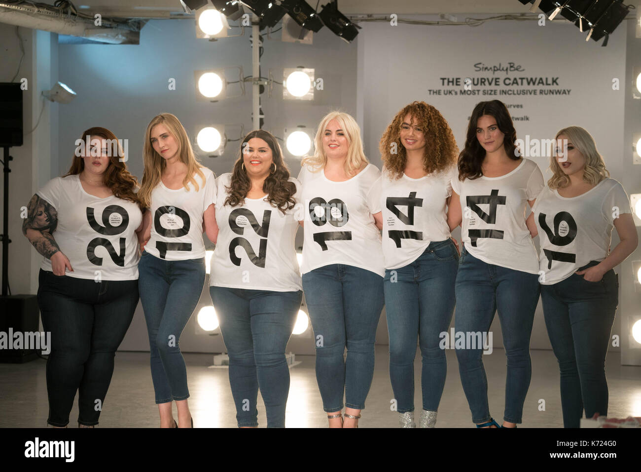London, UK. 14th Sep, 2017. Models (left to right) Tess Holliday, Kelly Knox, Callie Thorpe, Felicity Hayward, Sonny, Ali Tate and Hayley Hasselhof wearing tee shirts with their sizes on at a photo call for the Curve Catwalk, a fashion show celebrating diversity of body shapes and forms, at The Vinyl Factory as part of London Fashion Week in London. Photo date: Thursday, September 14, 2017. Photo credit should read Credit: Roger Garfield/Alamy Live News - Stock Image