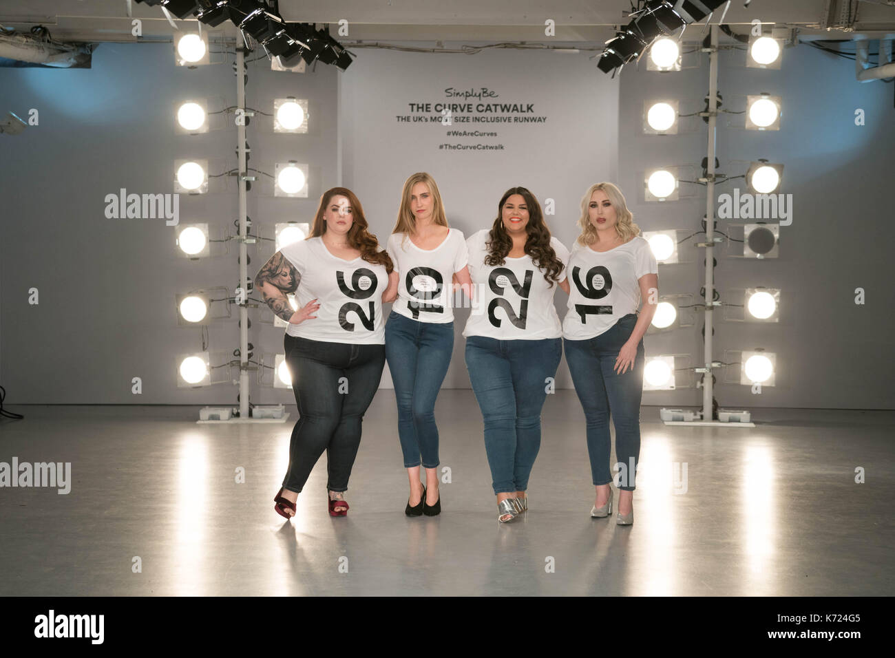 London, UK. 14th Sep, 2017. Models (left to right) Tess Holliday, Kelly Knox, Callie Thorpe and Hayley Hasselhof wearing tee shirts with their sizes on at a photo call for the Curve Catwalk, a fashion show celebrating diversity of body shapes and forms, at The Vinyl Factory as part of London Fashion Week in London. Photo date: Thursday, September 14, 2017. Photo credit should read Credit: Roger Garfield/Alamy Live News - Stock Image