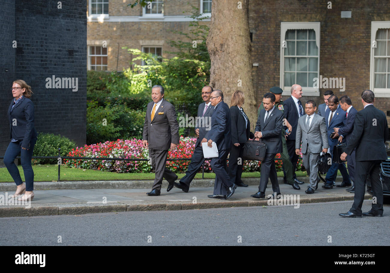 10 Downing Street, London UK. 14 September, 2017. The Prime Minister of Malaysia, Najib Razak, is welcomed to 10 Downing Street by British PM Theresa May. The Malaysian delegation lead Minister of Foreign Affairs Anifah Aman MP into No 10. Credit: Malcolm Park/Alamy Live News. - Stock Image