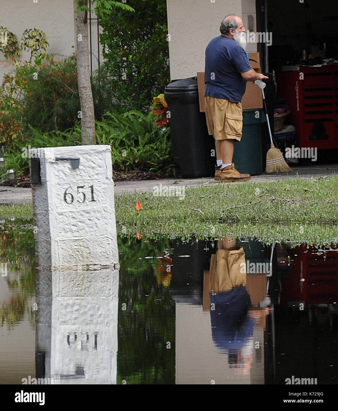 Altamonte Springs, United States. 14th Sep, 2017. September 14, 2017- Altamonte Springs, Florida, United States - A man and his mailbox are seen reflected in flood waters in the street in the Spring Oaks neighborhood of Altamonte Springs, Florida on September 14, 2017. Emergency workers used boats and trucks to rescue more than 50 residents on September 11, 2017 when water from the nearby Little Wekiva River swamped their homes in the wake of Hurricane Irma. Credit: Paul Hennessy/Alamy Live News - Stock Image