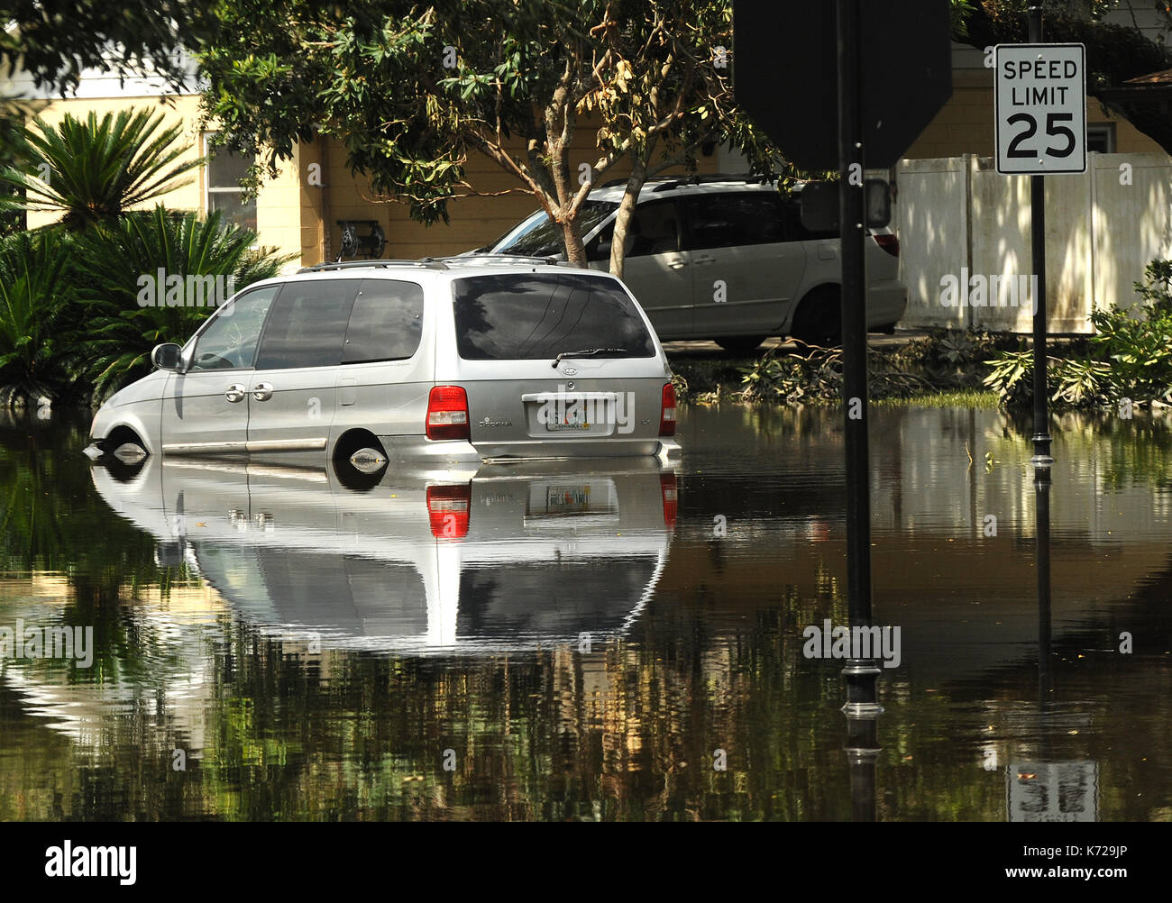 Altamonte Springs, United States. 14th Sep, 2017. September 14, 2017- Altamonte Springs, Florida, United States - A van is seen reflected in flood waters in the street in the Spring Oaks neighborhood of Altamonte Springs, Florida on September 14, 2017. Emergency workers used boats and trucks to rescue more than 50 residents on September 11, 2017 when water from the nearby Little Wekiva River swamped their homes in the wake of Hurricane Irma. Credit: Paul Hennessy/Alamy Live News - Stock Image