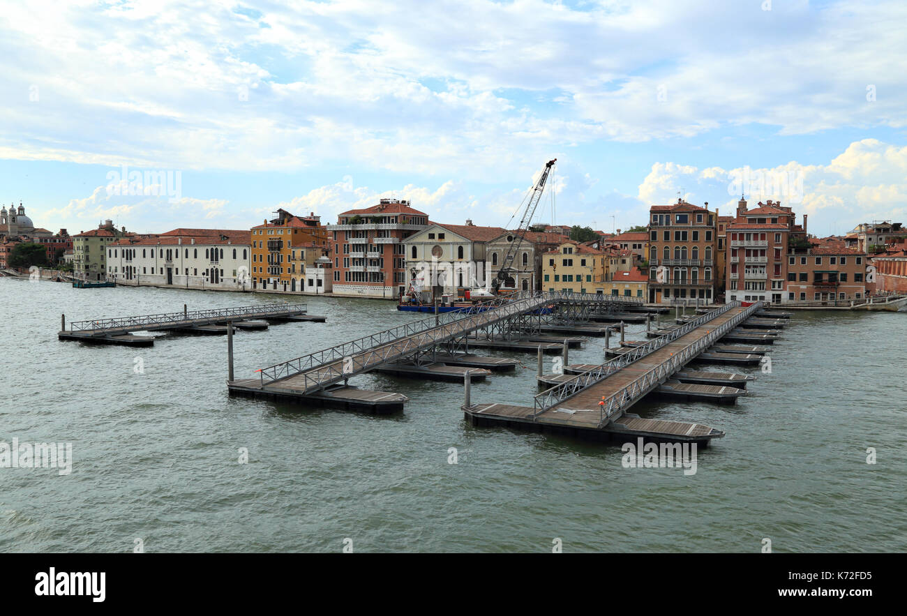 Preparation of the pontoon bridge over the Giudecca Canal at Festa del Redentore - Stock Image
