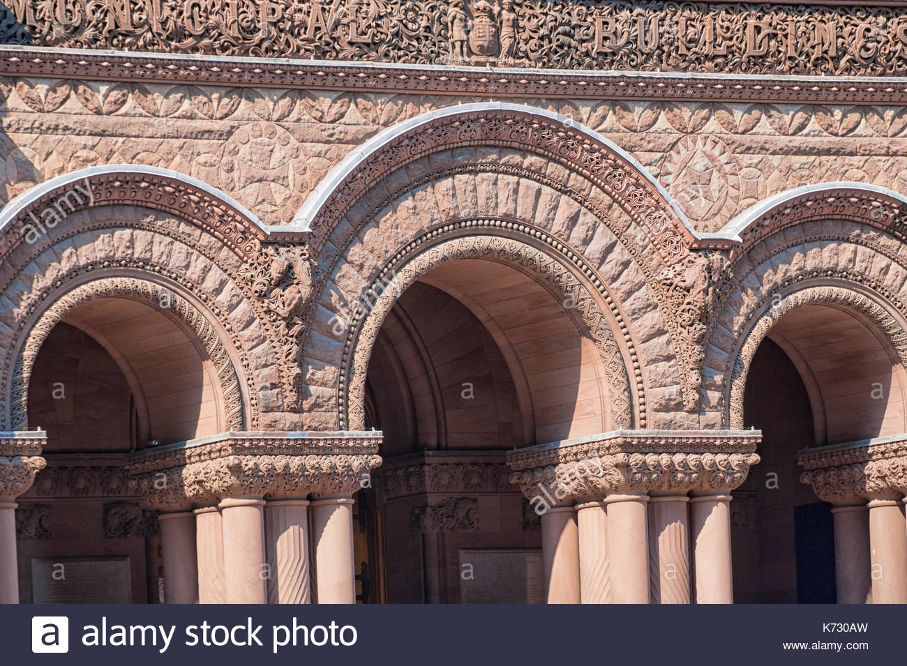Old City Hall Richardsonian Romanesque Revival architectural details. Arches in the facade.The red stone old building is a tourist attraction in the C - Stock Image