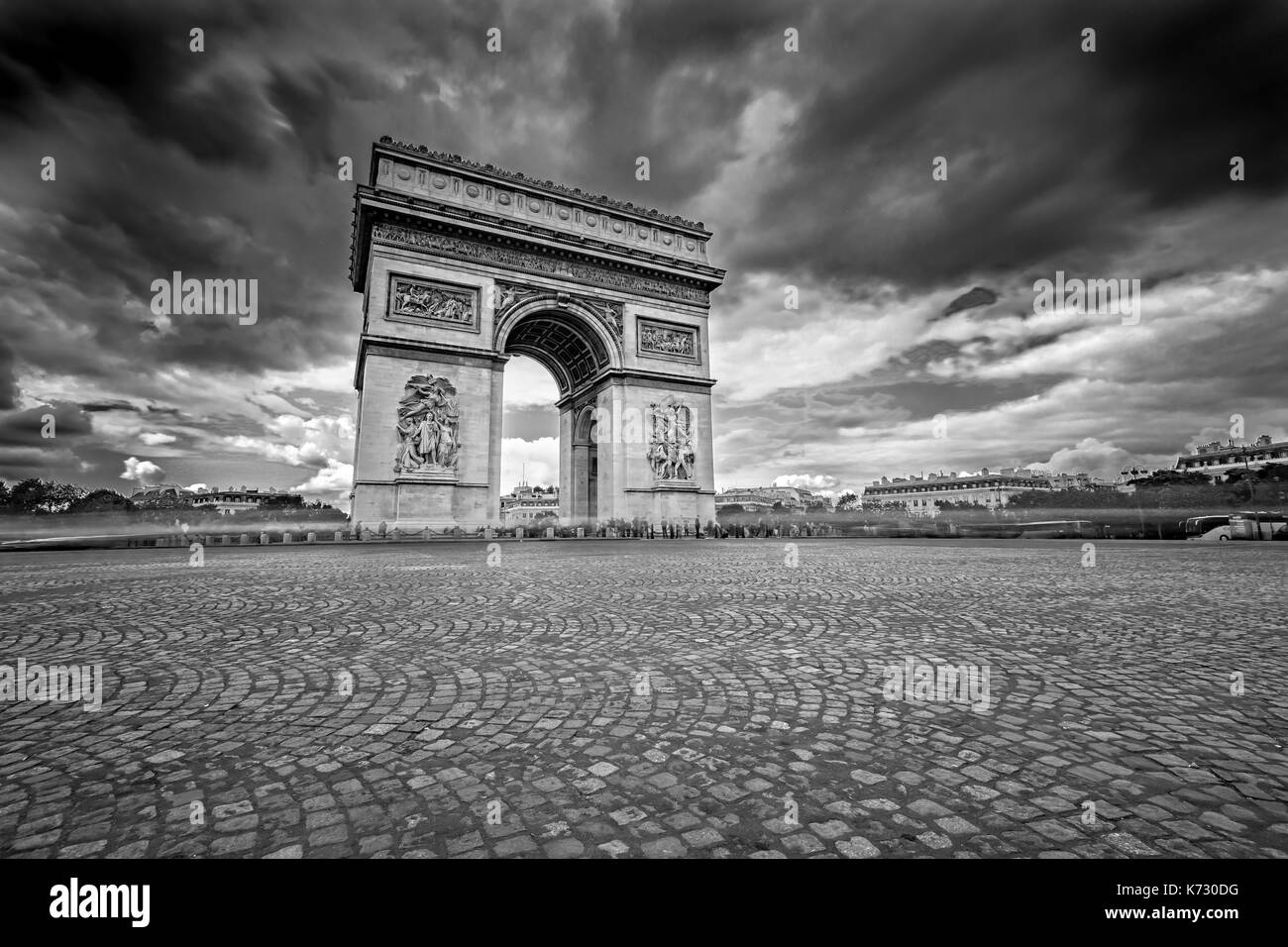 Dark Clouds coming over the Arc de Triomphe in Paris, France - Stock Image
