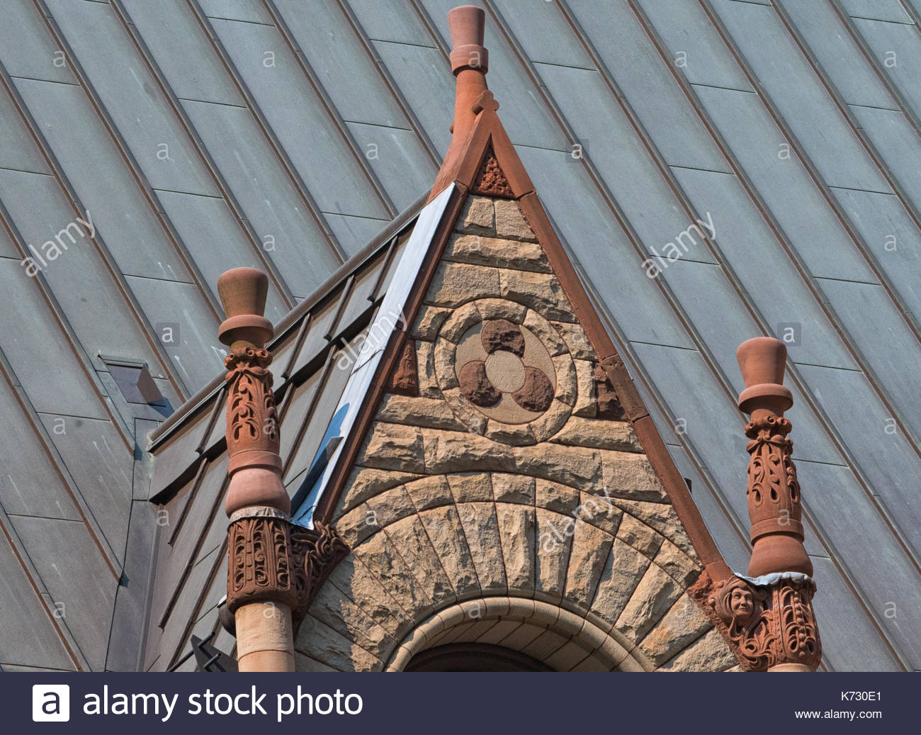Old City Hall Richardsonian Romanesque Revival architectural details. A turret in the roof.  The red stone old building is a tourist attraction in the - Stock Image
