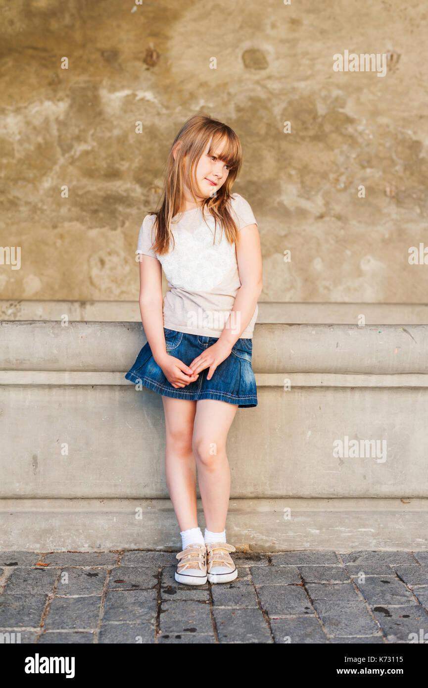 Outdoor portrait of cute little girl - Stock Image