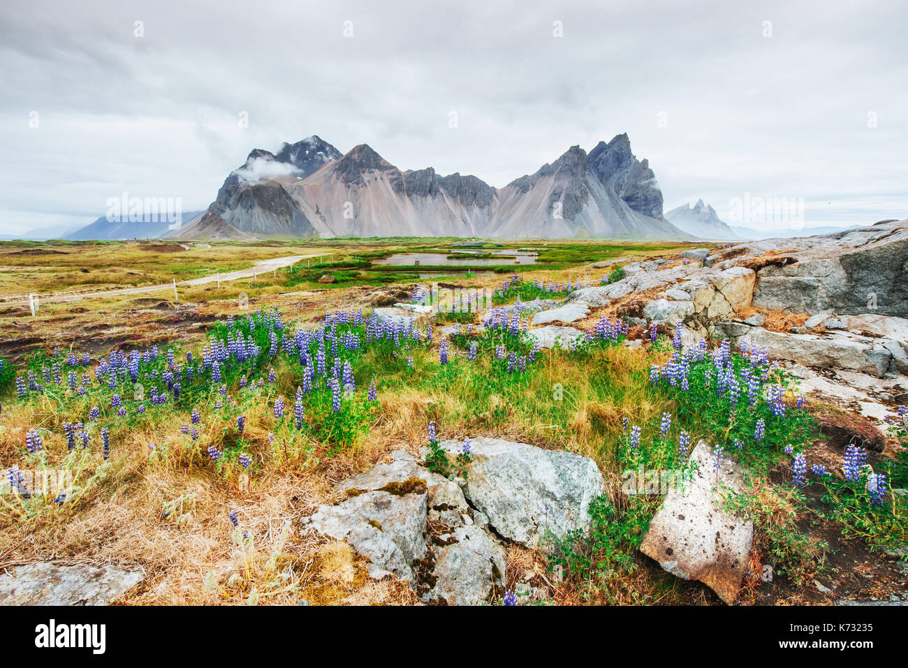 Gentle slopes of snow-capped mountains and glaciers. Wonderful Iceland in the spring. - Stock Image