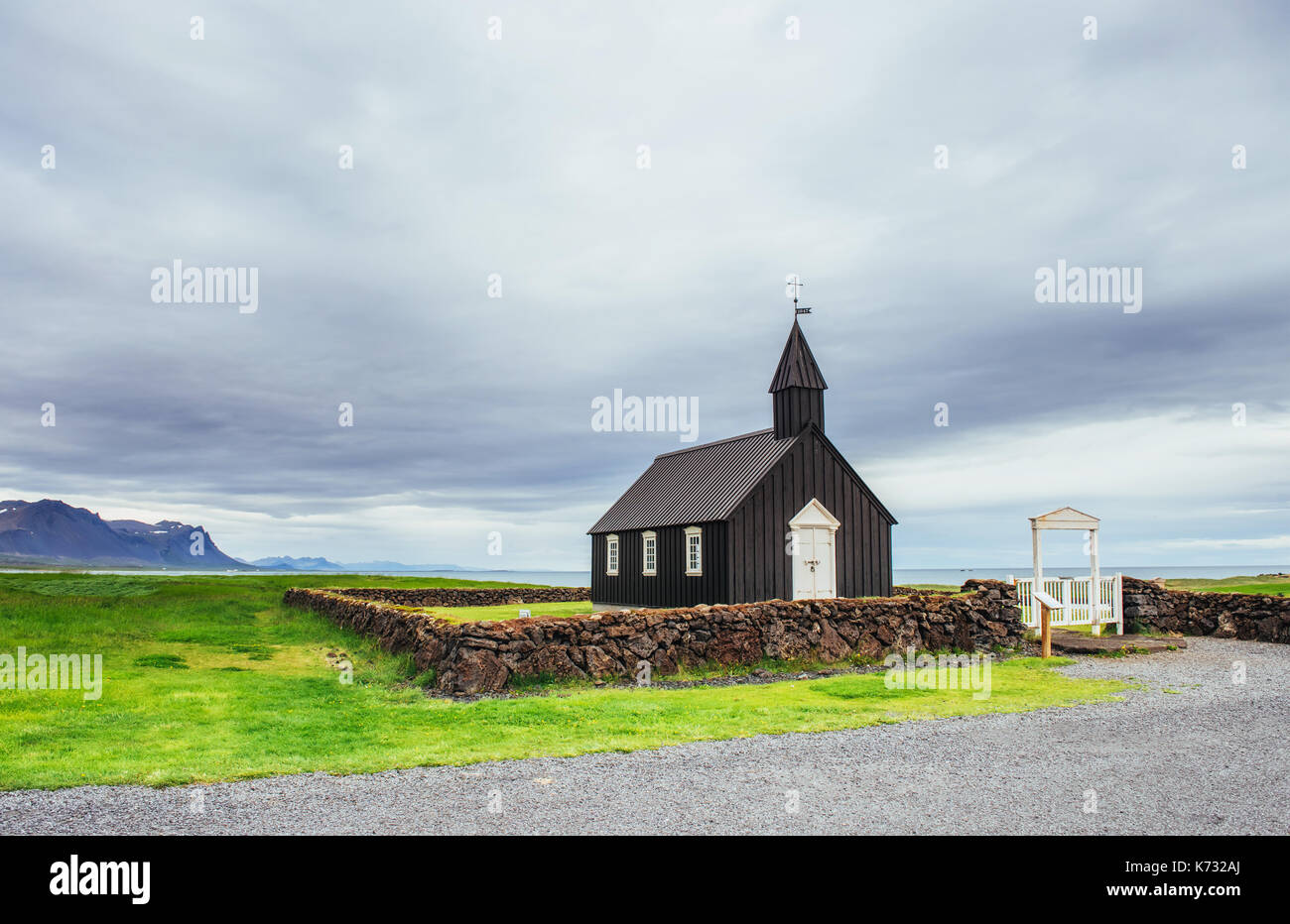 Mountain View Iceland. Beautiful black wooden church in Budir - Stock Image