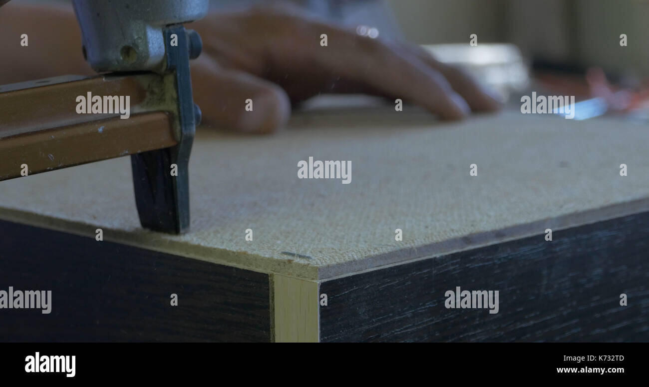 Using Staple Gun To Fix Back Side Of The Closet In Furniture Factory,  Closeup