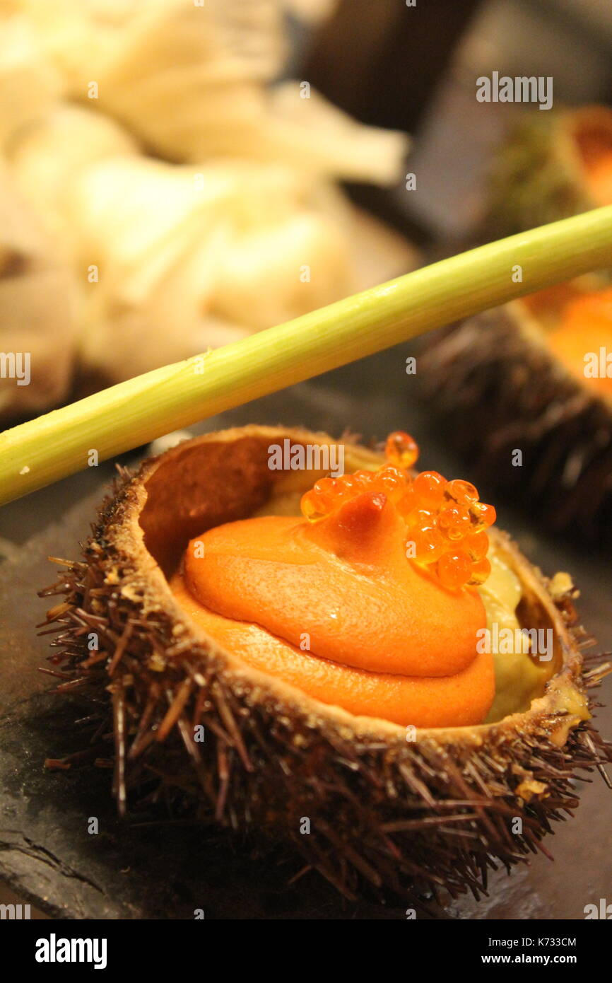 Sea Urchin Served with Orange Mousse and Caviar at a Bar in San Sebastian. - Stock Image