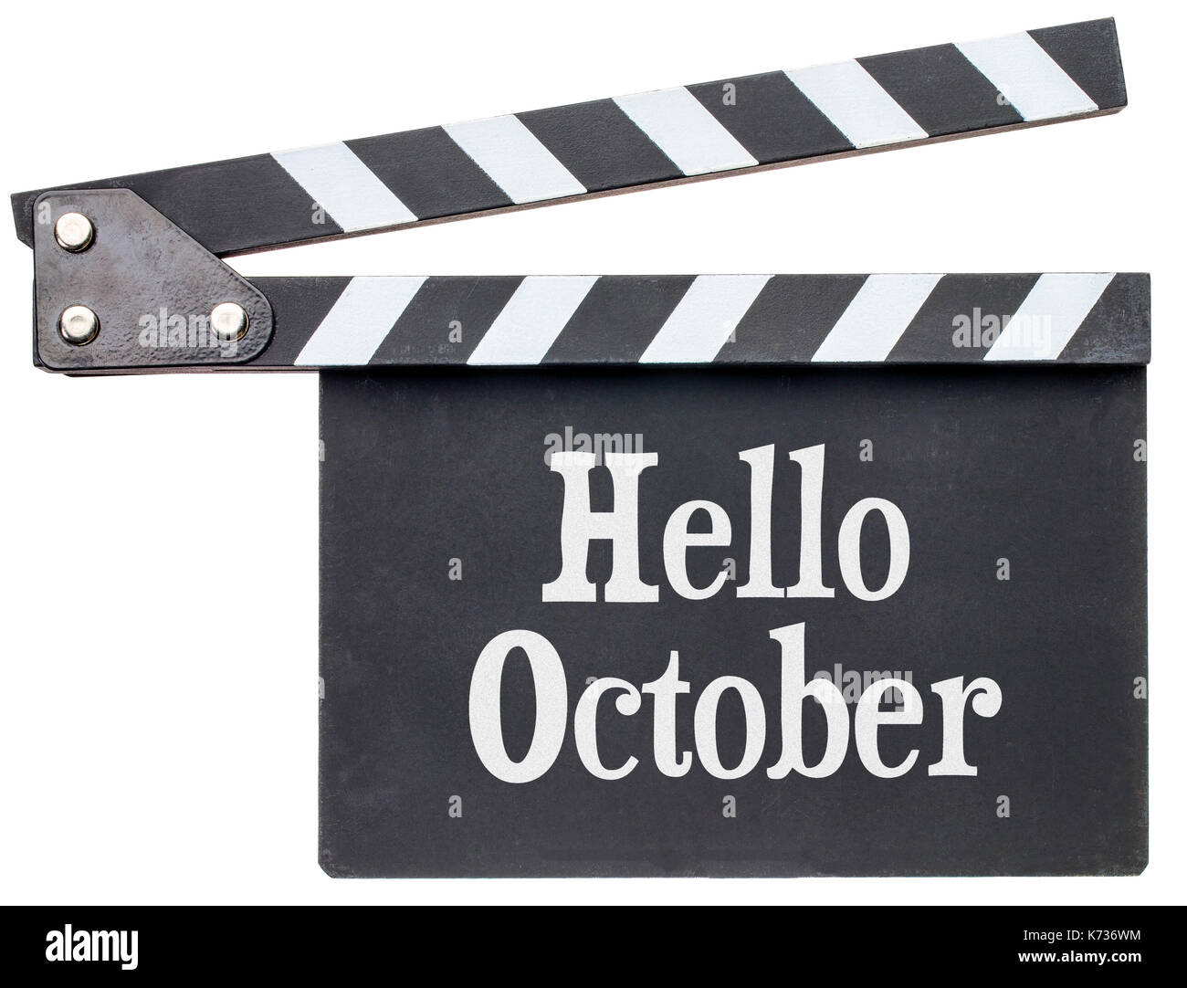 Hello October movie title in white chalk on clapboard isolated on white - Stock Image