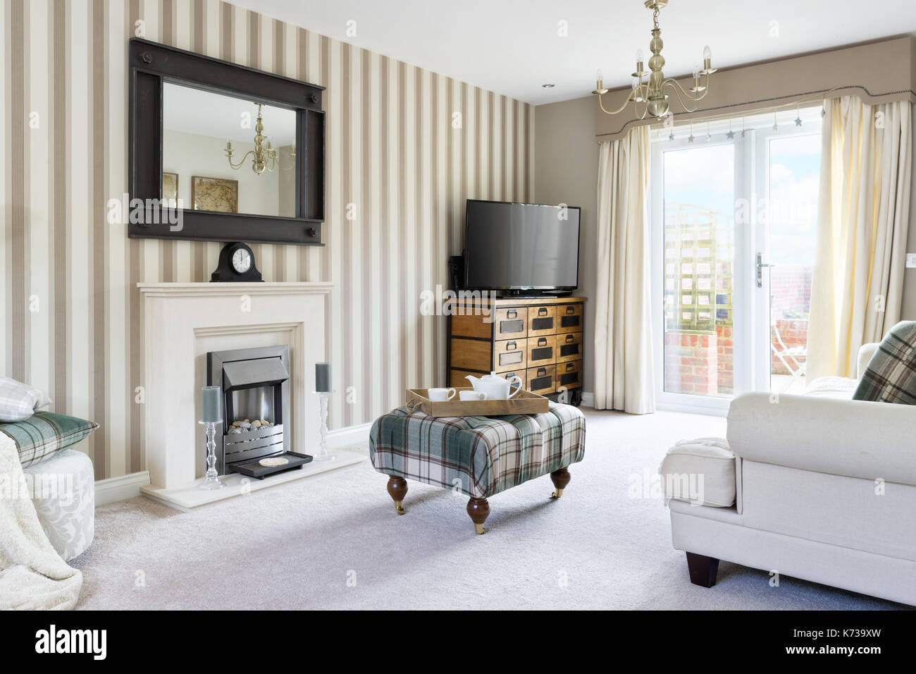 A stylish, interior designed living room in a contemporary UK home - Stock Image