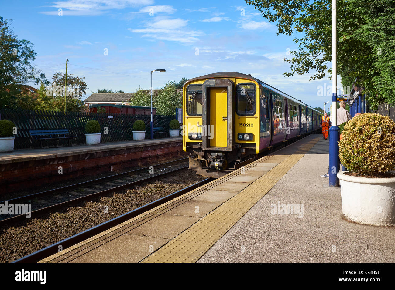 British Rail Class 150 'Sprinter' diesel multiple-units (DMUs; DMU) arriving at Poppleton Station, York, United Kingdom on a sunny day. - Stock Image