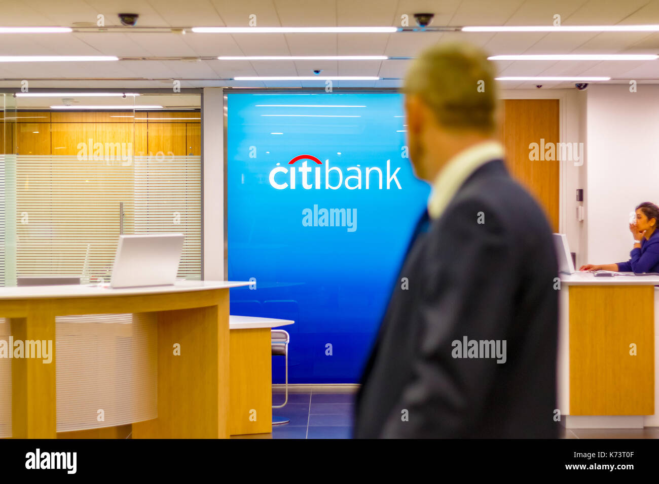 London, UK - September 15, 2017 - Citibank sign displayed at a branch in Canary Wharf with people passing by in the foreground - Stock Image