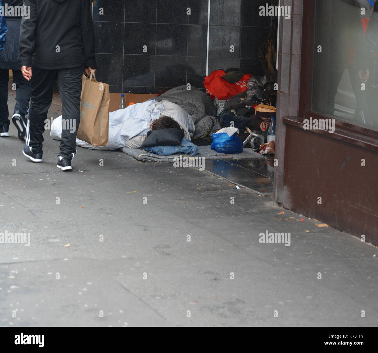 Homeless Person Sleeping In A Doorway Stock Photos