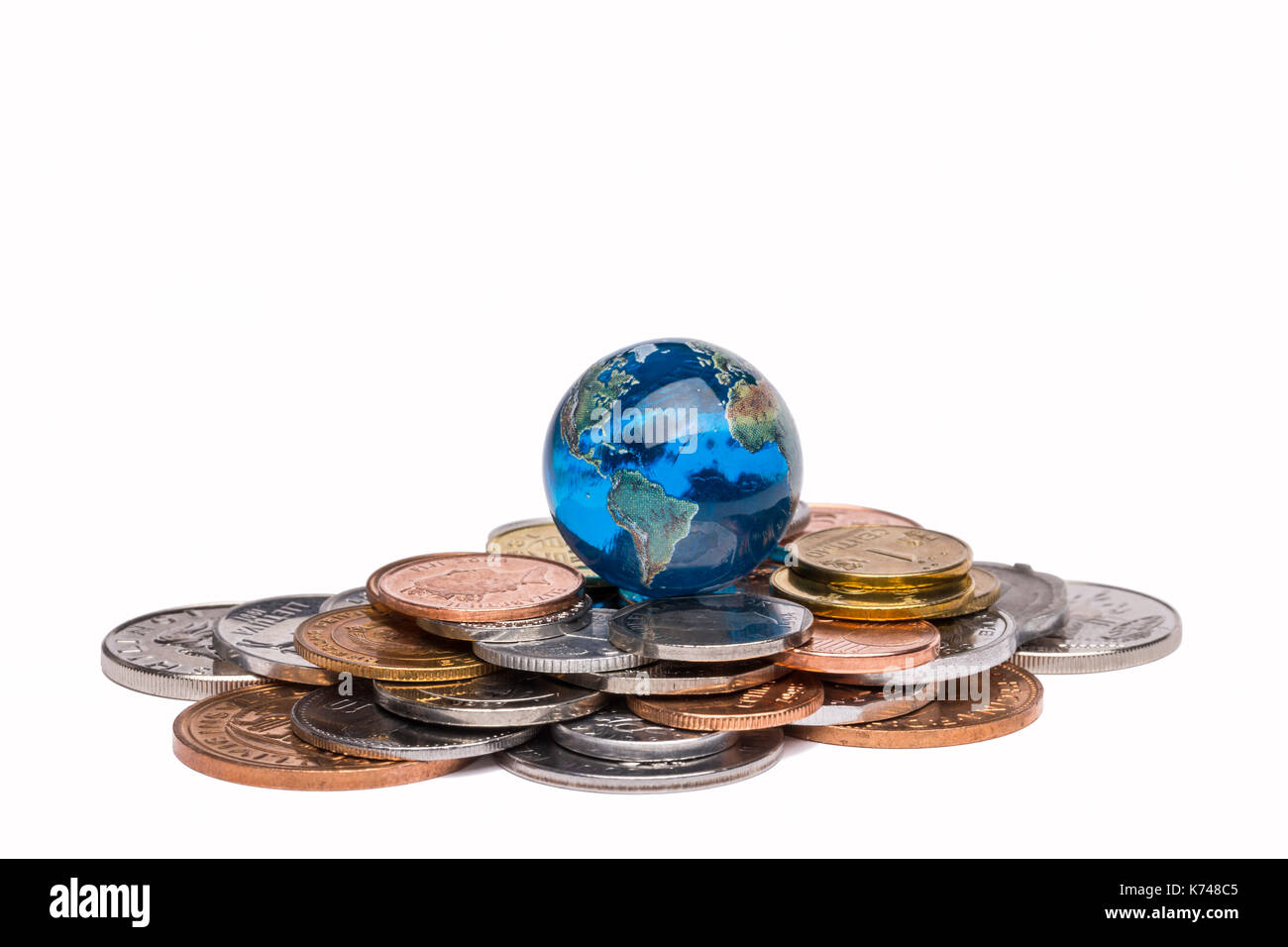 Earth Globe On Coins - Stock Image