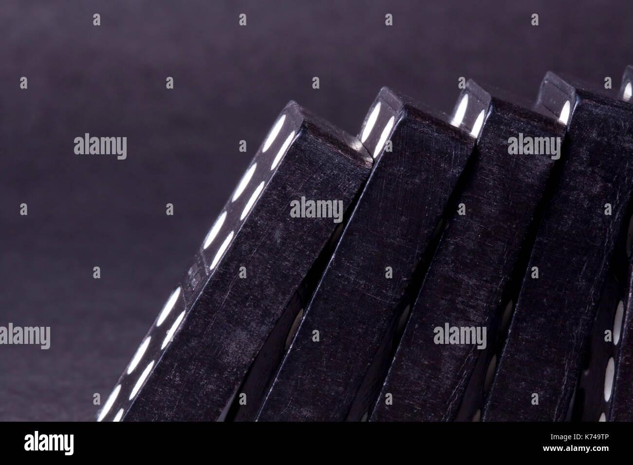 Black Dominos Toppled Over Stock Photo