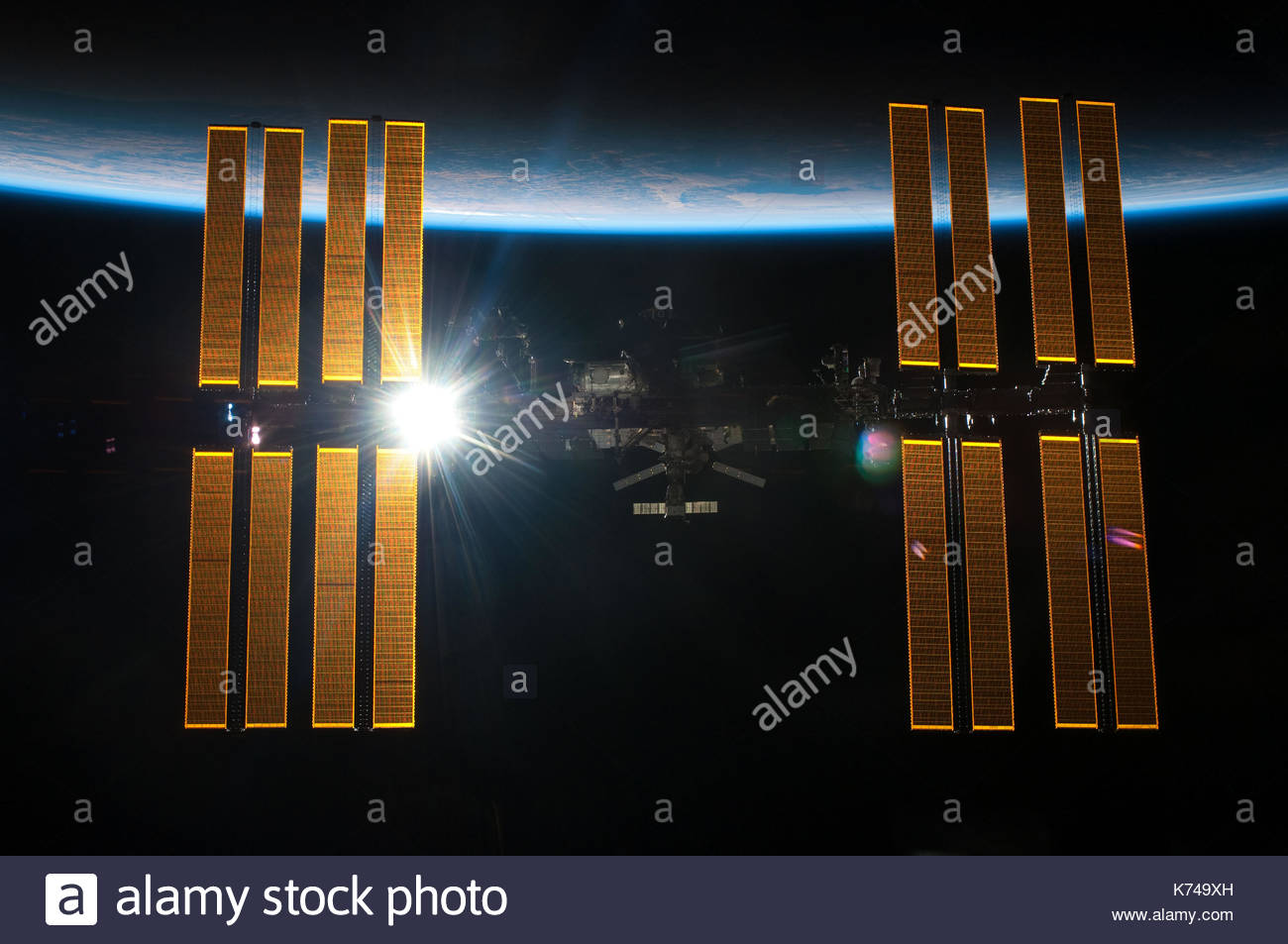 ISS or International Space Station. The spacecraft is a habitable artificial satellite, in low Earth orbit. Elements of this image furnished by NASA - Stock Image