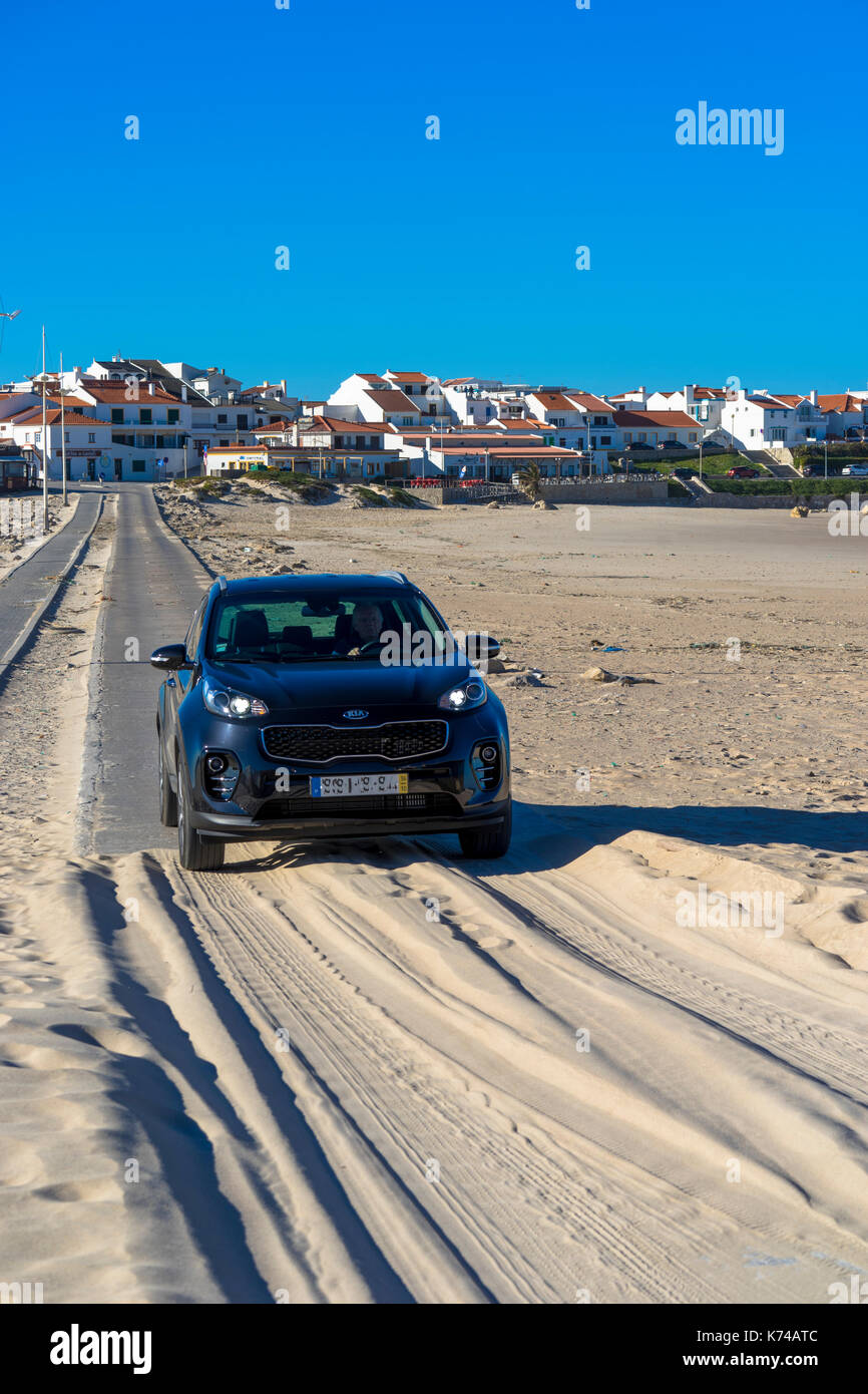 Kia Sportage car crossing the causeway or tombolo from the island of Baleal Portugal Stock Photo