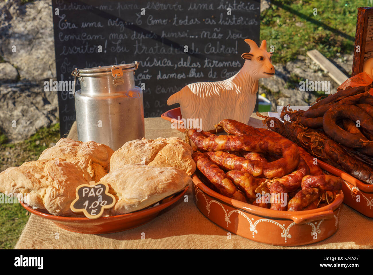 Bread and Portuguese sausages on sale at outdoor event in Portugal - Stock Image