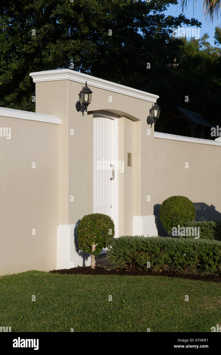 Wall With Modern Entrance Gate On A Sunny Day Stock Photo Alamy