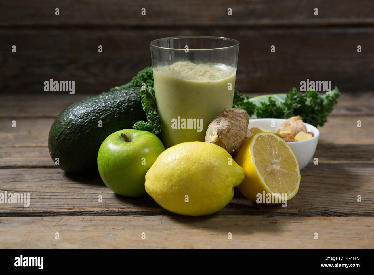 Various ingredients and paste on wooden table - Stock Image
