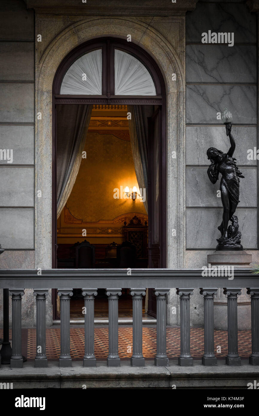 View through the door allows to see luxurious interior of a neoclassical palace built on 19th century in Brazil, Stock Photo