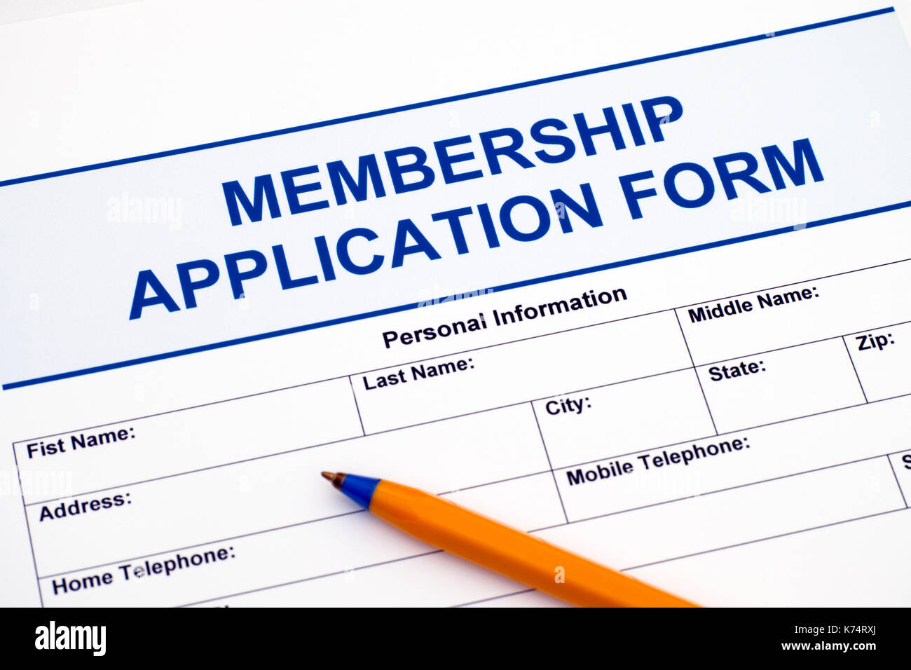 Membership application form with ballpoint pen. - Stock Image