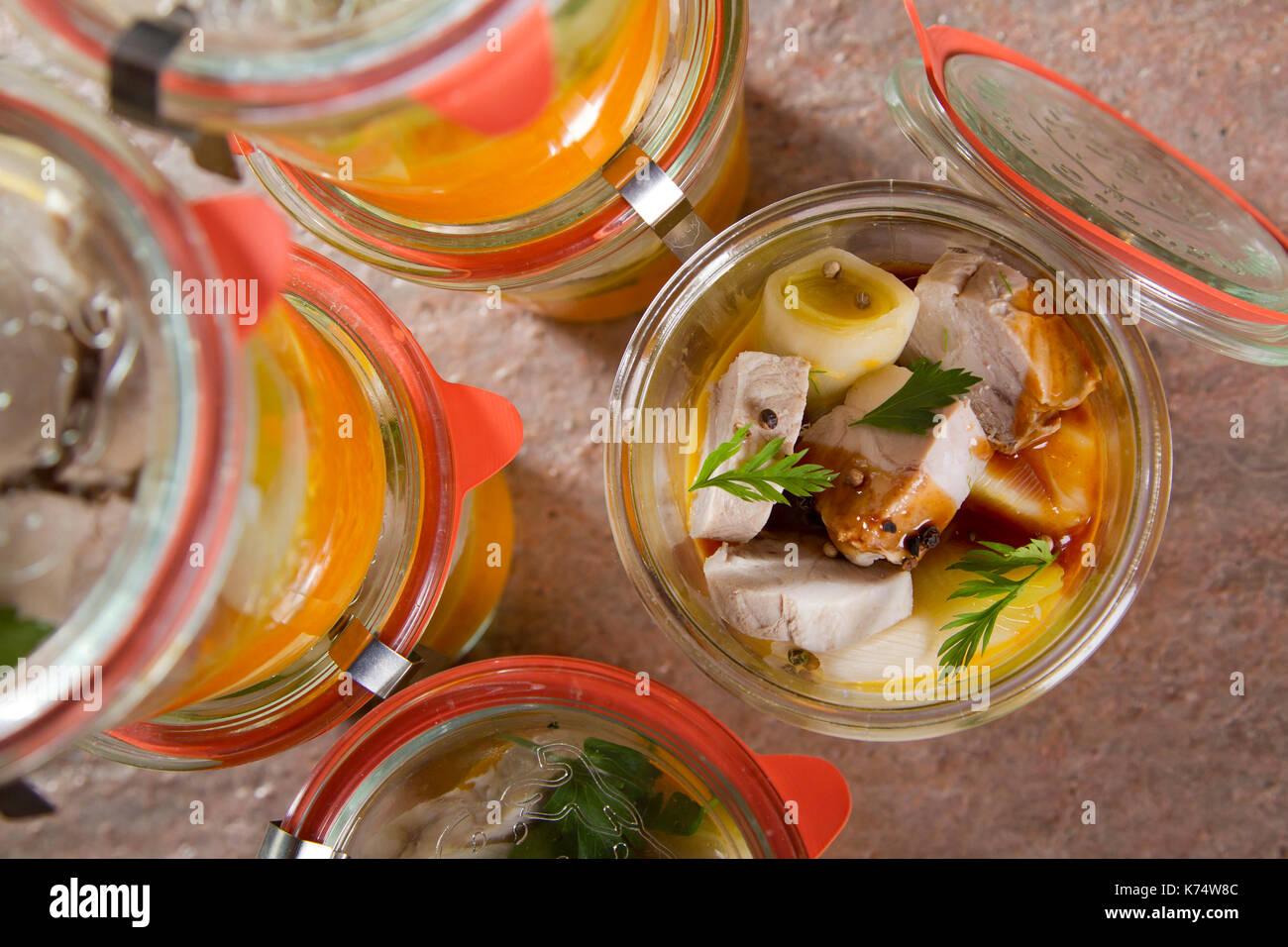 Rack of pork in a preserving jar. - Stock Image