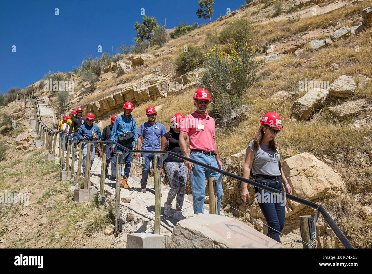 Tourists visiting the Cal Orck'o cliff in the Parque Cretácico / Cretaceous Park famous for its dinosaur footprints, Sucre, Bolivia - Stock Image