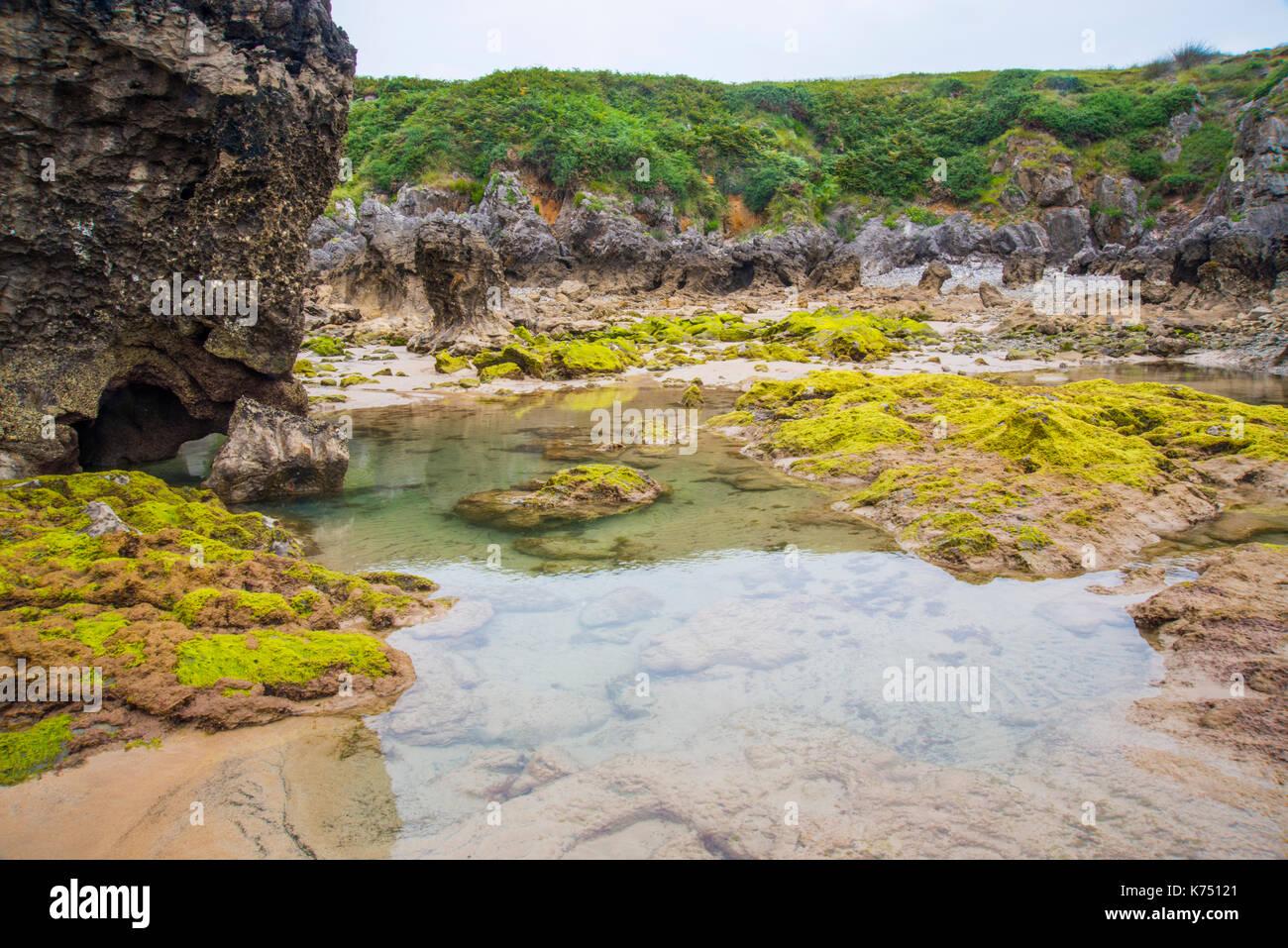 Puddles. Torimbia beach, Niembro, Asturias, Spain. - Stock Image