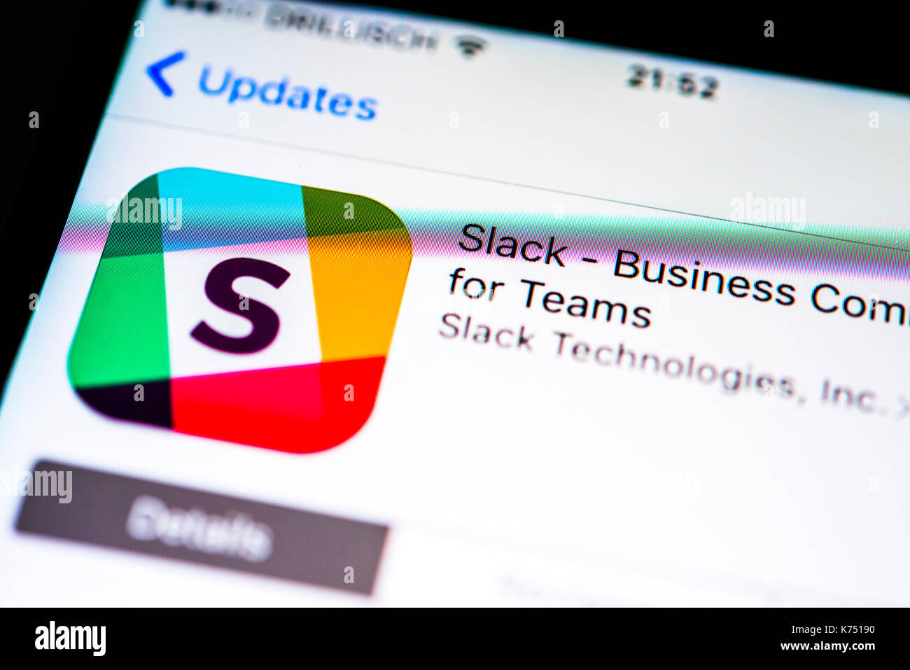 Slack app in the Apple App Store, app icon, display on a screen of a mobile phone, iPhone, iOS, smartphone, macro recording - Stock Image